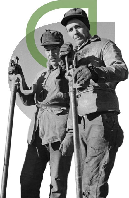 Black & white image of two construction labourers