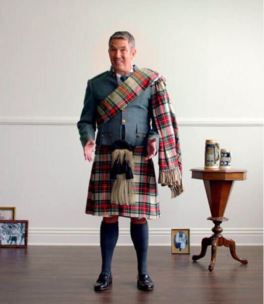 Kyle wearing traditional Scottish kilt.